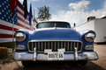 American car and flag USA on route 66 Royalty Free Stock Photo