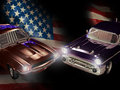 American classic cars close up on a ford mustang and a chevrolet bel air in the foreground of an usa flag Royalty Free Stock Photography