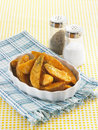 American country style crispy fries wind from the rural fabric and the salt shaker pepper pot bring crisp french Royalty Free Stock Photography