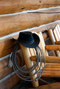 American cowboy still life this symbolic image of the is set against a genuine log cabin a coiled lariat is draped on a wooden Royalty Free Stock Image