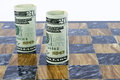 American currency stands on marble game board Royalty Free Stock Photo