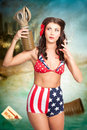 American danger girl pinup beauty on toxic beach grunge portrait of a beautiful military pin up woman removing gas mask war torn Stock Images