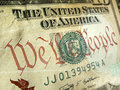 American dollar with we the people inscription highlighted a macro close up photo emphasizing printed on back of a united states Stock Photos