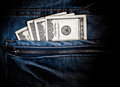 American dollars in a jeans pocket Stock Photos