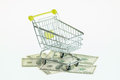 American dollars and shopping cart over white background Royalty Free Stock Image