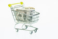 American dollars in shopping cart over white background Stock Photo