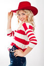 American-dressed girl in red hat Stock Photography