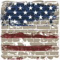 The American flag against a brick wall. Stock Images
