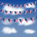 American flag bunting in a blue sky Royalty Free Stock Image