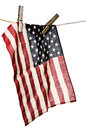 American flag on a clothesline with wooden clothespins old Stock Photo
