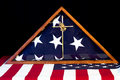 American flag encased given as gift for veteran after his death to spouse or family member in triangle box with brass cross and Stock Images