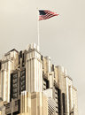 American flag flying atop skyscraper Stock Photos