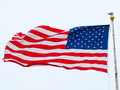 American flag flying in a light breeze Royalty Free Stock Images