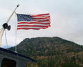 American flag flying with mountains in the background Royalty Free Stock Photo