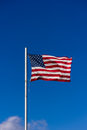 American flag flying in the wind Stock Photo
