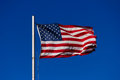 American flag flying in the wind Stock Images
