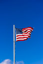 American flag flying in the wind Stock Image