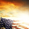 American flag in front of bright sky Royalty Free Stock Photos