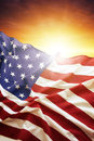 American flag in front of bright sky Stock Photo