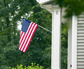 American flag front door hanging in of a house Stock Image