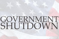 American flag with government shutdown words the on an old usa Royalty Free Stock Photography