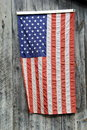 American flag hanging on gray barn wood Royalty Free Stock Photo