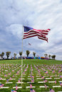 American Flag and Headstones at United States National Cemetery Stock Photo