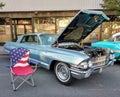 American Flag Lawn Chair Near a Classic Car at a Car Show Royalty Free Stock Photo