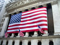 American flag on nyse outside new york stock exchange Royalty Free Stock Photo