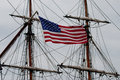 American flag with rigging flying tall ship Stock Photos