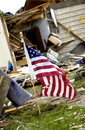 American Flag standing within Storm Damage Royalty Free Stock Photography
