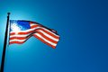 American flag sunlit from behind picture of the Stock Image