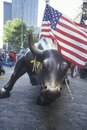 American Flag Tied to Sculpture of Bull, Wall Street, New York City, New York Royalty Free Stock Photo