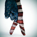 American flag walking a man hand with its fingers painted as simulating someone Stock Photography