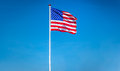 American Flag Waving In The Wi...