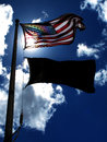 American Flag on Windy Day Sunlight Blue Sky and Clouds Royalty Free Stock Photo