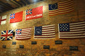 American flags a wall display of the evolution of the flag including the famous betsy ross flag top right at the fraunces tavern Royalty Free Stock Photos