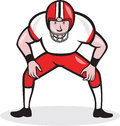 American football center snap front cartoon illustration of an gridiron player squatting ready to facing on isolated background Stock Photos
