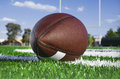 American football on find with goal posts close up of Stock Image