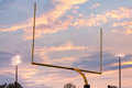 American football goal posts against sunset Royalty Free Stock Photo