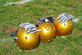 American football helmets and gloves Royalty Free Stock Photo