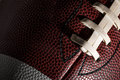 American football macro of a ball with visible laces stitches and pigskin pattern Royalty Free Stock Photos