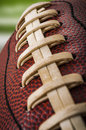 American football macro of a vintage worn ball with visible laces stitches and pigskin pattern Stock Photography