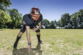 American football offensive lineman in action player at three point stance Royalty Free Stock Image