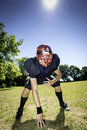 American football offensive lineman player in three point stance Stock Photography