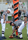 American Football officials measure for first down Royalty Free Stock Image