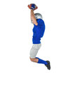 American football player catching ball in mid-air Royalty Free Stock Photo