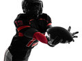 American football player catching ball silhouette one in shadow on white background Stock Photography