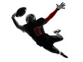 American football player catching ball silhouette one in shadow on white background Royalty Free Stock Image
