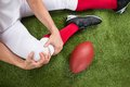 American football player with injury in leg close up of a on field Royalty Free Stock Images